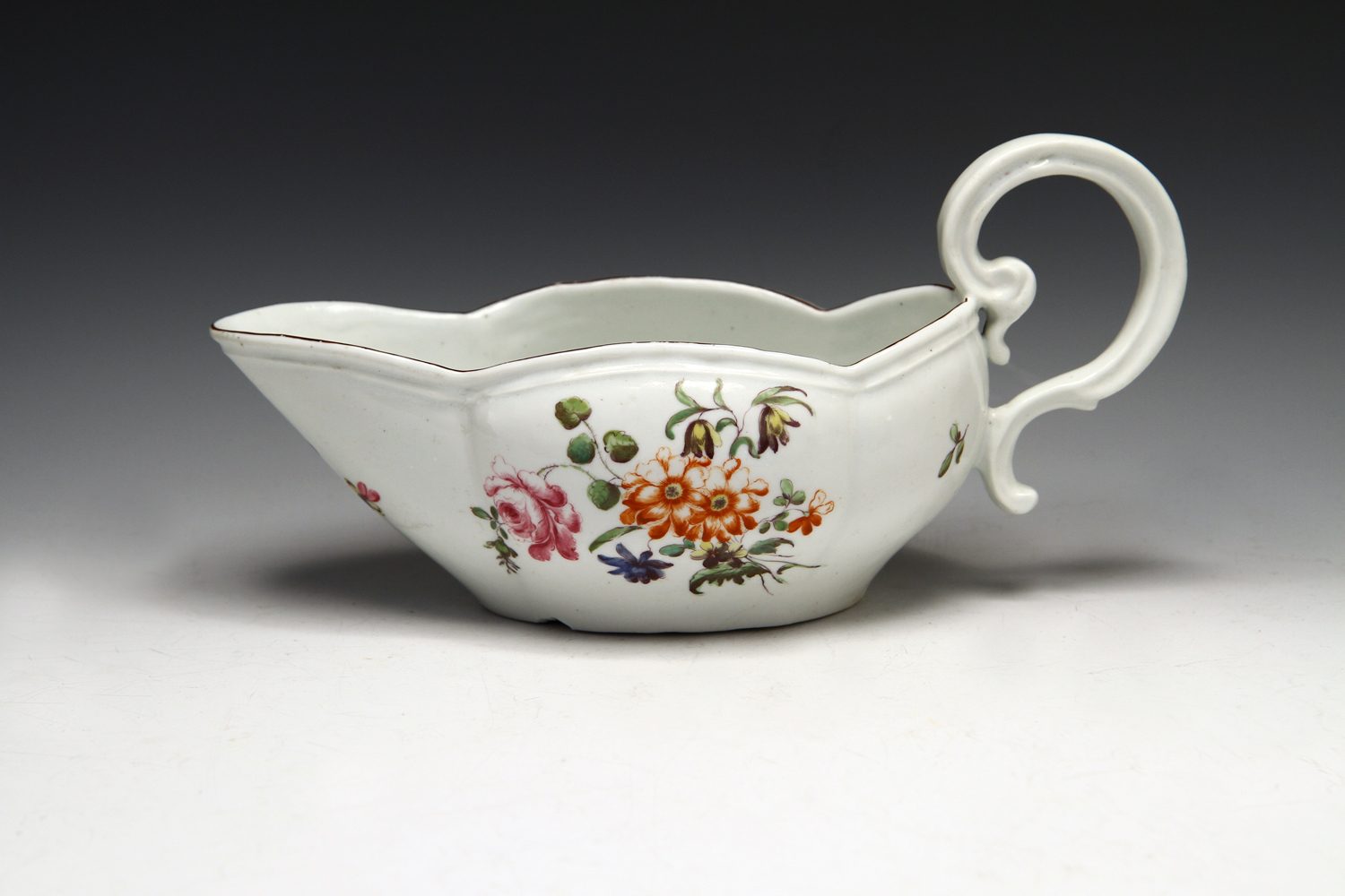 1033 - A good Derby polychrome sauceboat c 1758