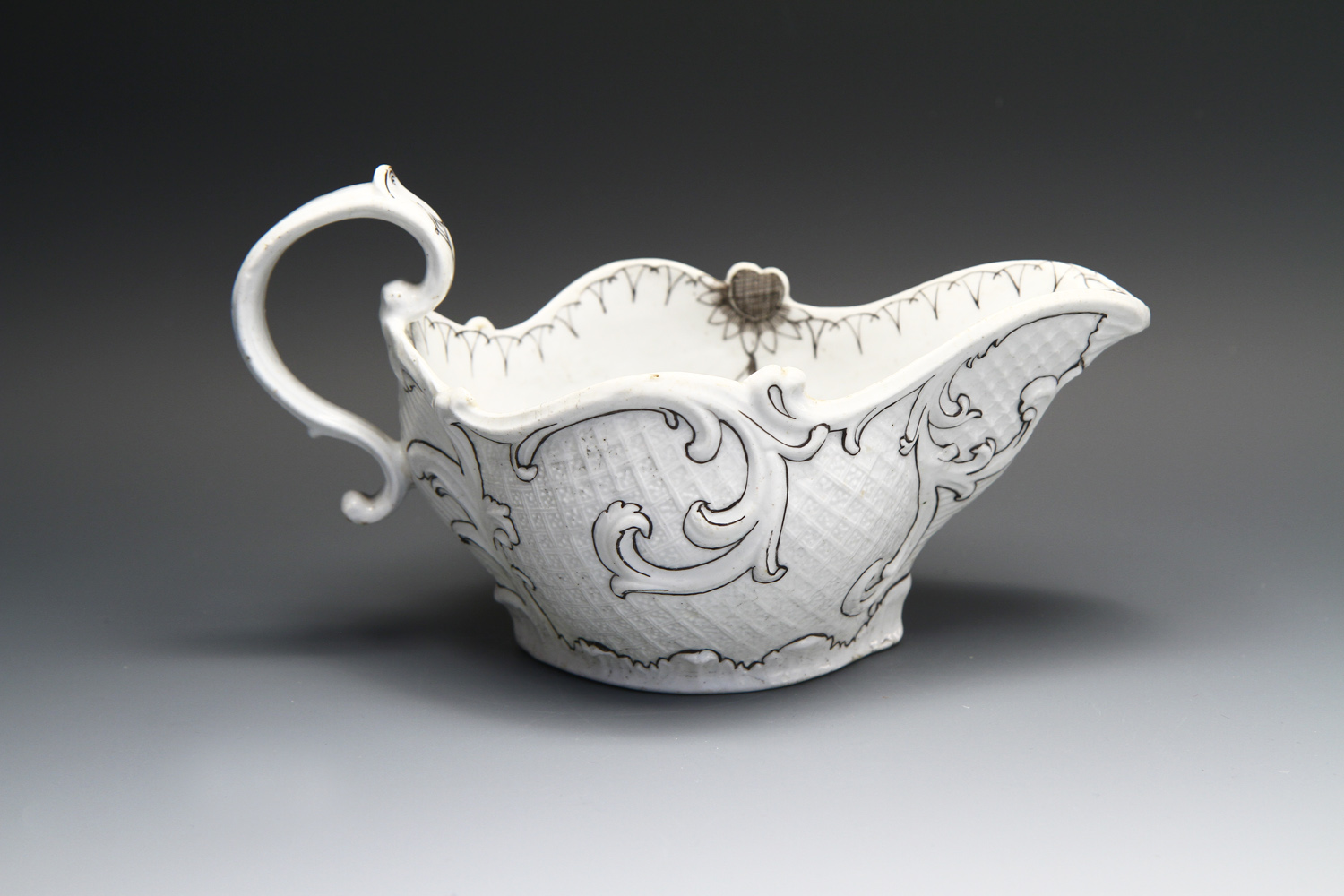 1081 - A fine Longton Hall sauceboat with pencilled decoration, c 1755