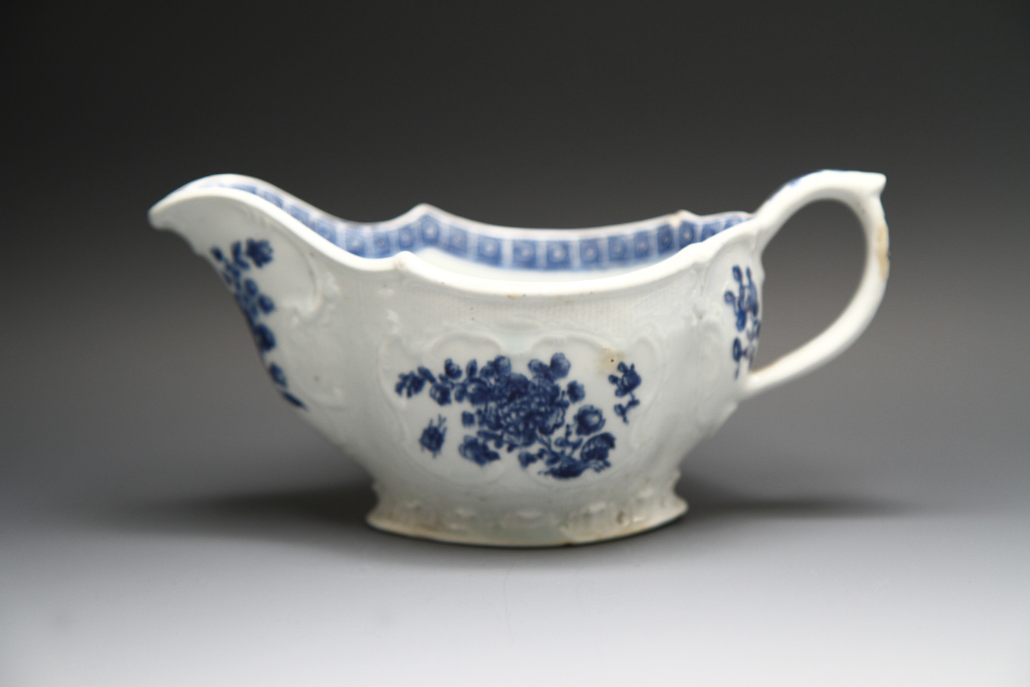 1123 - A rare Bow sauceboat possibly copying Liverpool, c 1765-70