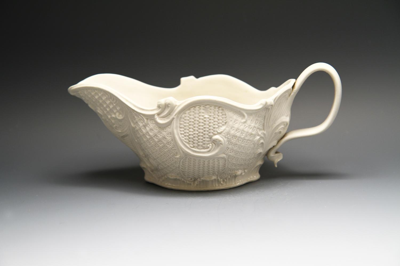 1088 - A crisply moulded saltglaze stoneware sauceboat c 1750-55