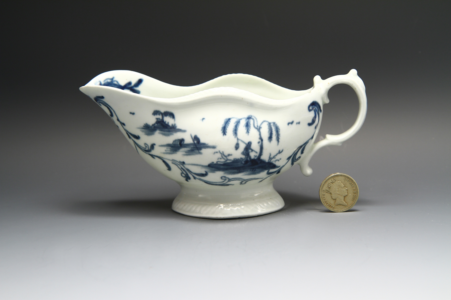 1116 - A worcester blue and white gadroon edged sauceboat c 1765-8