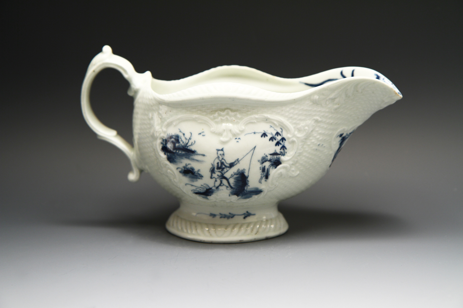 1091 - A good Worcester sauceboat in the Man with Bomb pattern, c 1765-8