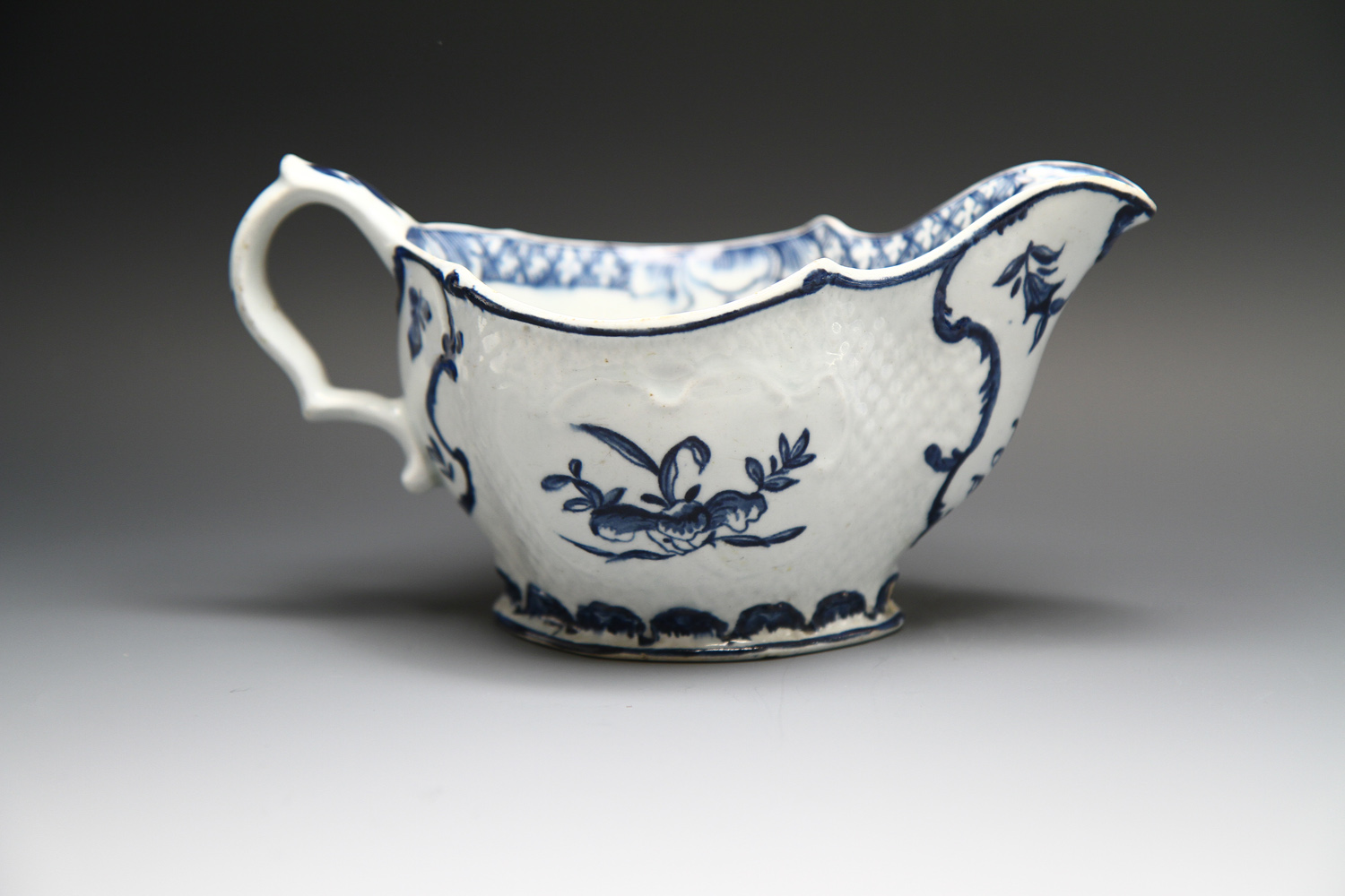 1122 - A rare Bow sauceboat possibly copying Liverpool, c 1765-70