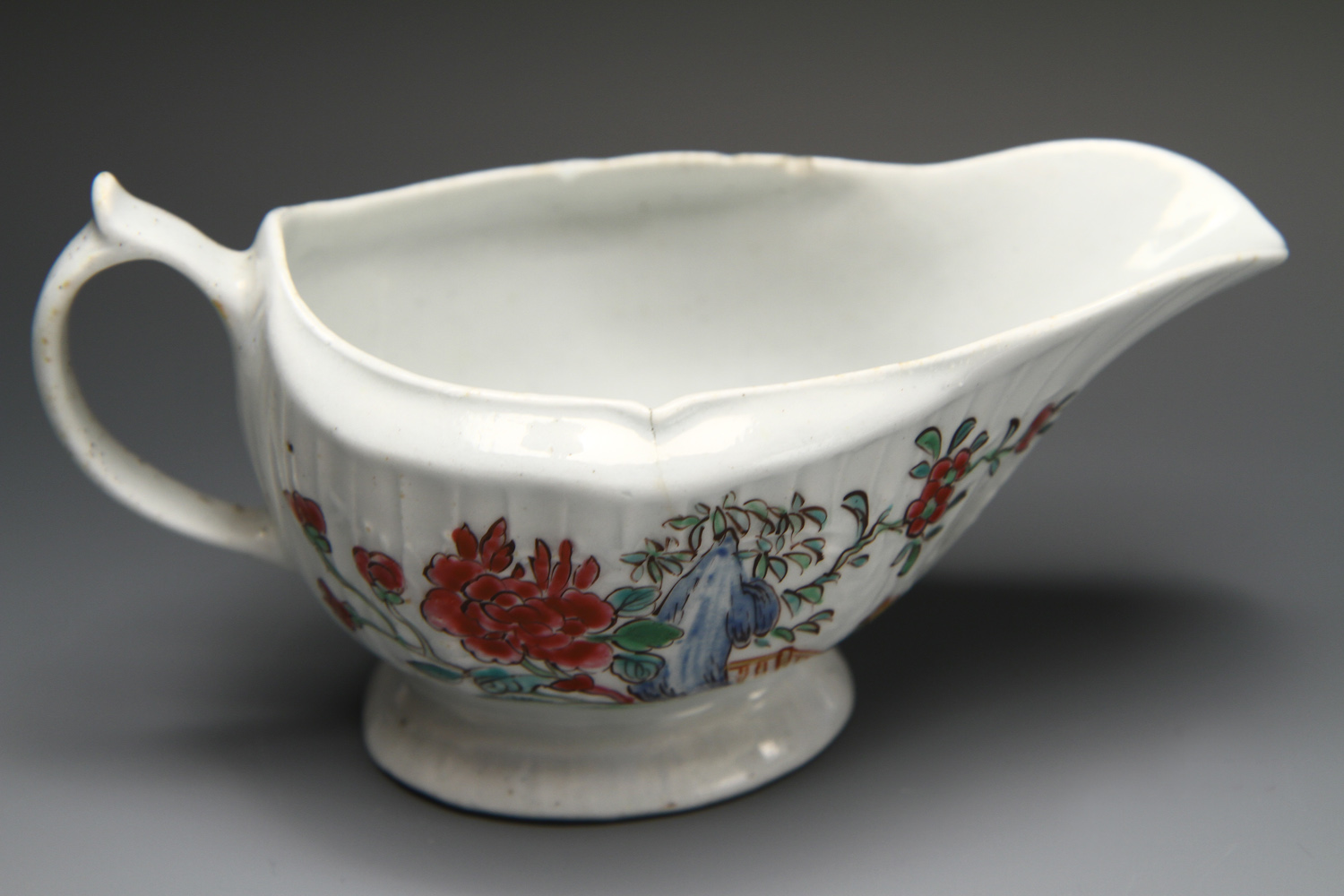 1084 -  A rare Christian Liverpool sauceboat with polychrome decoration c 1770.